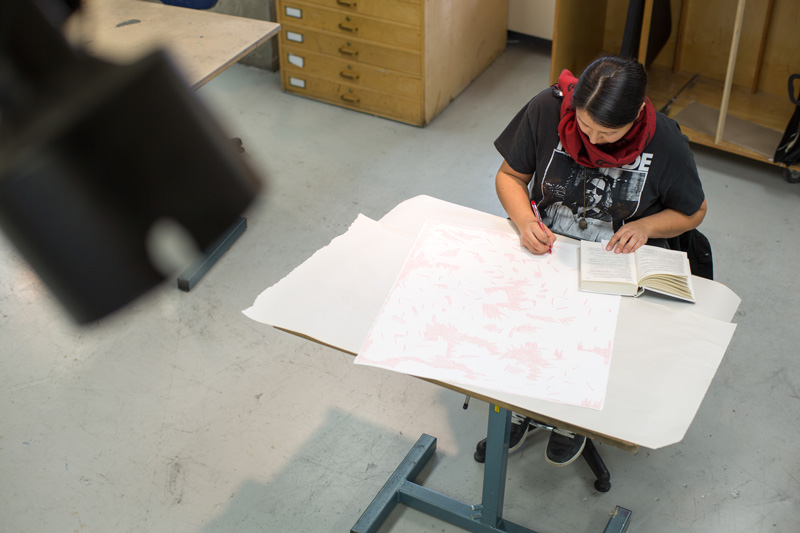 Student drawing in studio