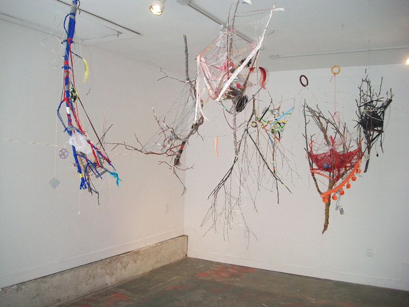 hanging art combining branches and yarn