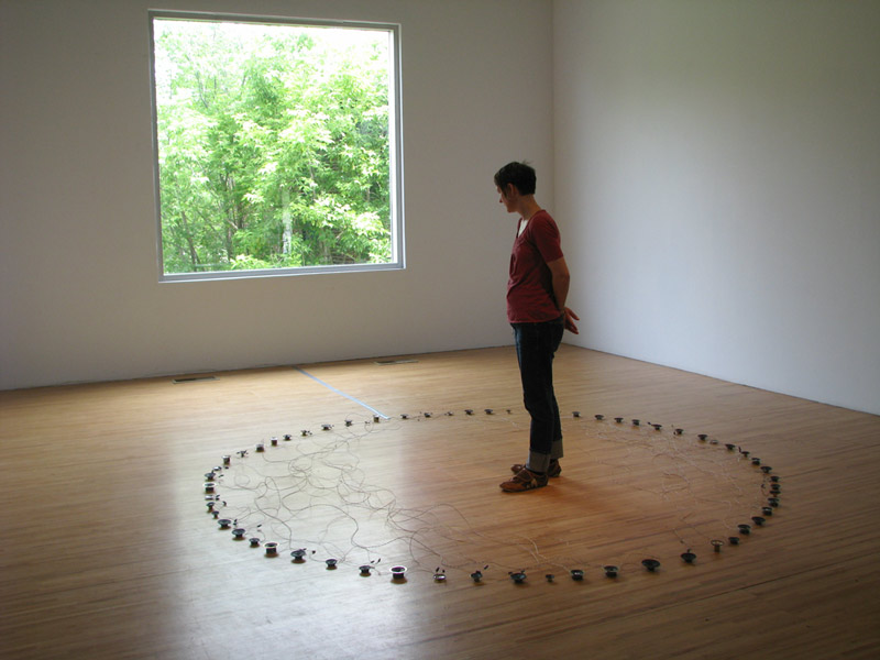 circle of small speakers on the floor