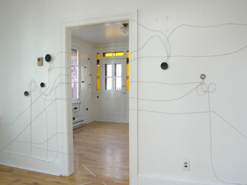 various sensors and outputs attached to different locations in a room