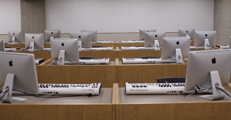 Lab of Mac computers and digital recording keyboards at each station