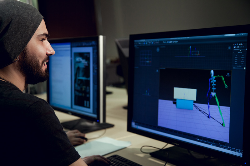 student 3d animating on computer station