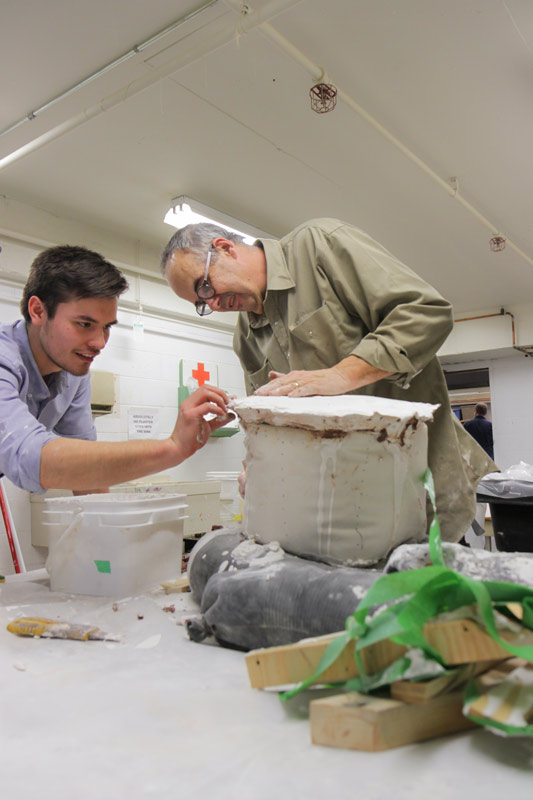 glen mackinnon and student working on sculpture