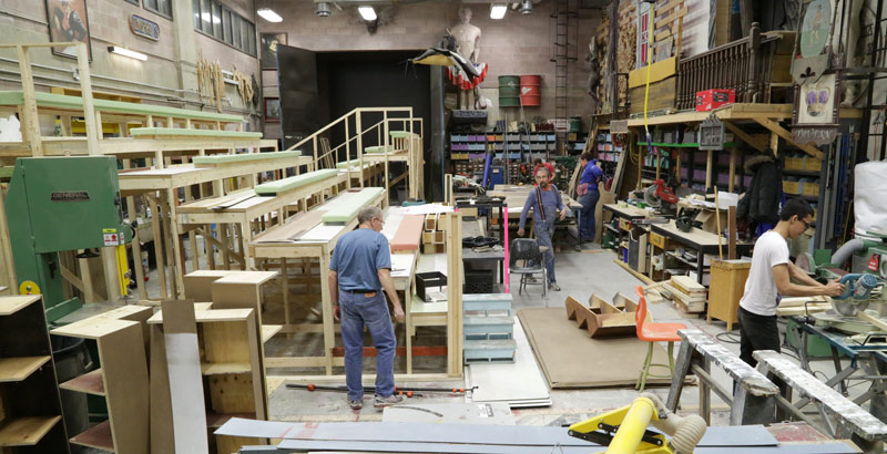 large shop with bleachers being constructed for stage production