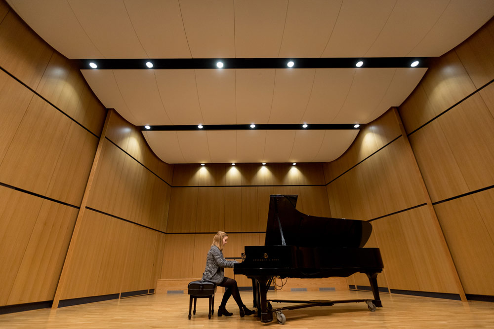 Recital hall stage with piano on it
