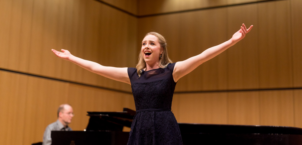 Singer with arms outstretched