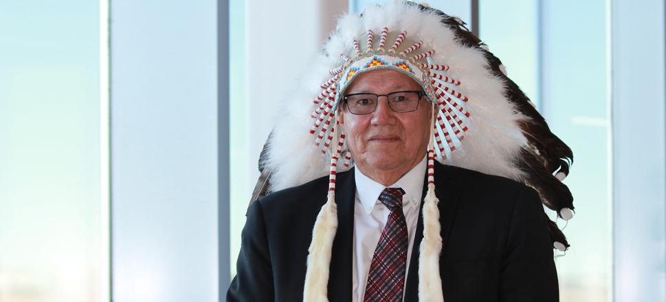 Portrait of Chancellor Charles Weaselhead in Blackfoot headdress