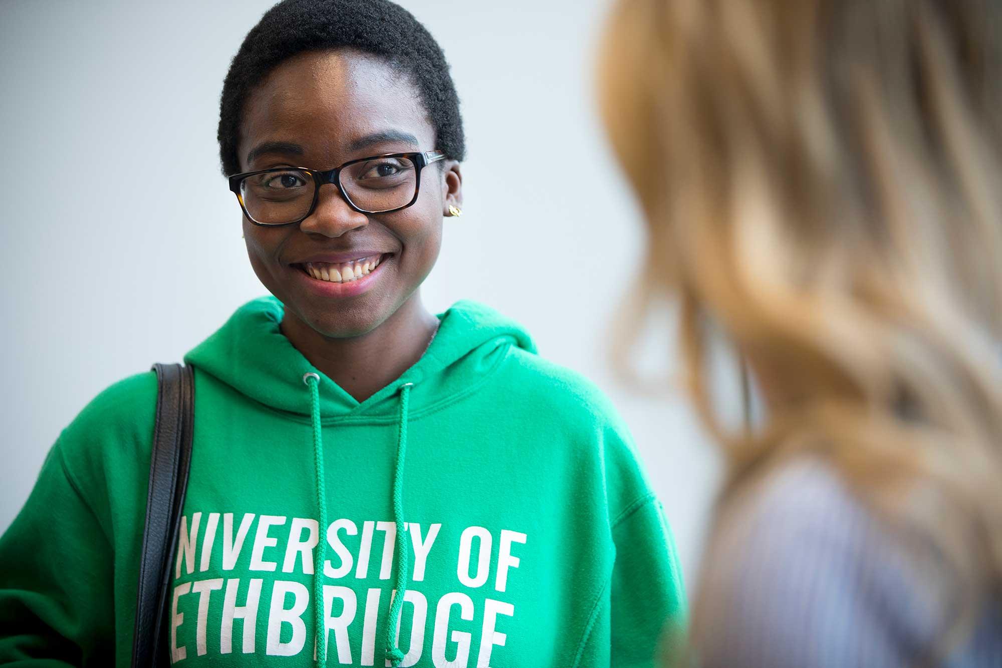 Smiling student wearing uLethbridge sweater