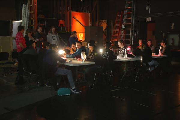 students working with lighting at tables