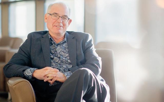 Bruce McKillop sitting in chair