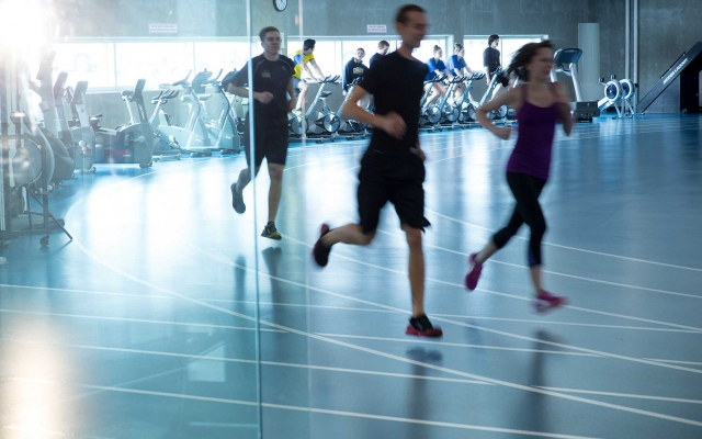 People running on indoor track
