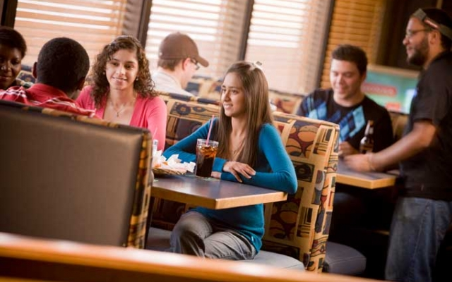 Students sitting at The Zoo, the campus pub