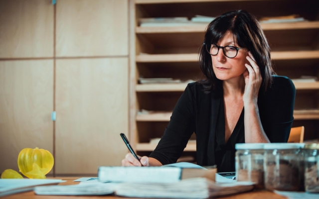 Mary Kavanagh sitting in art studio