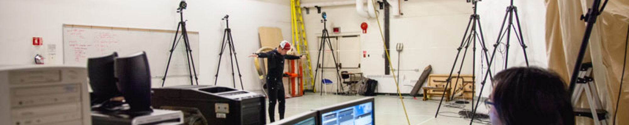 student wearing mocap suit