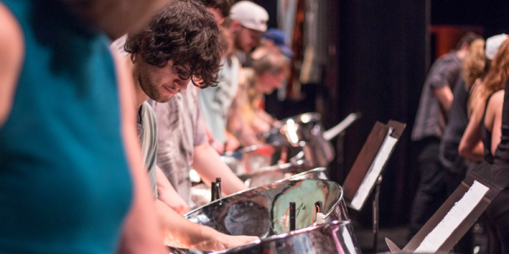 closeup of student playing steel drum