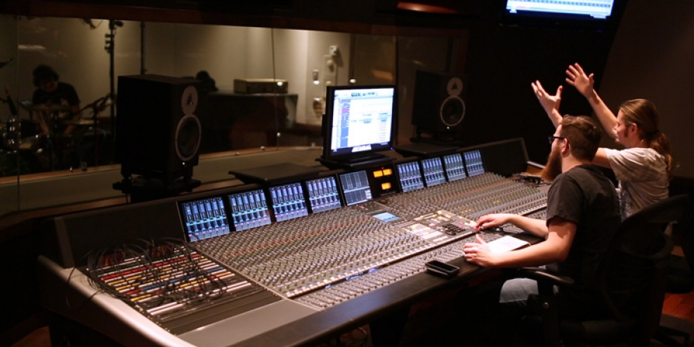 students recording and directing musicians