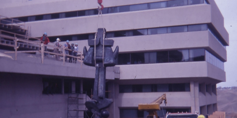 Moses sculpture being lifted by a crane