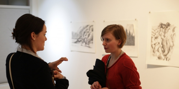 art students talking at student exhibition