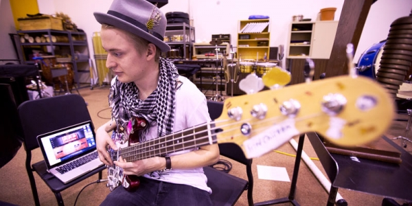 Student playing electric bass