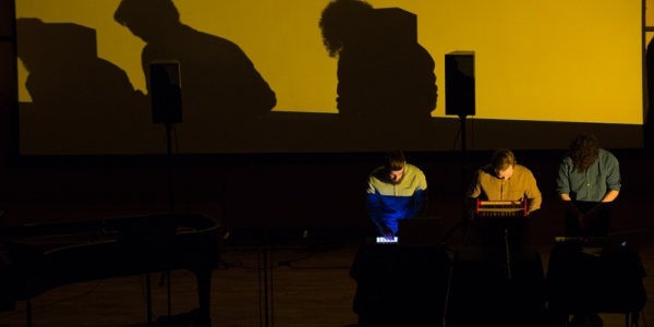students performing electroacoustic music in the recital hall