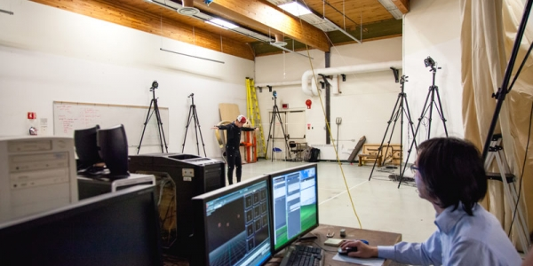 wide shot of motion capture area and computers