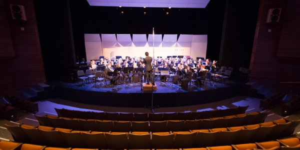 Wind orchestra performing on stage