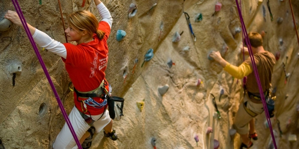 People on climbing wall