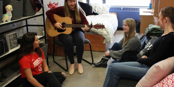 Students hanging out with guitar