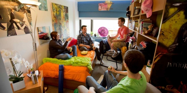 Students hanging out in dorm room