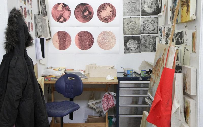 Desk with drawings on walls