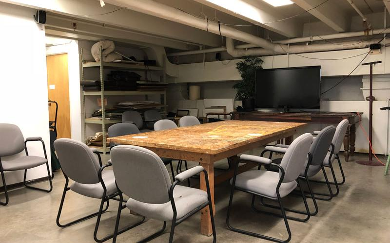Room with table, chairs, and a TV