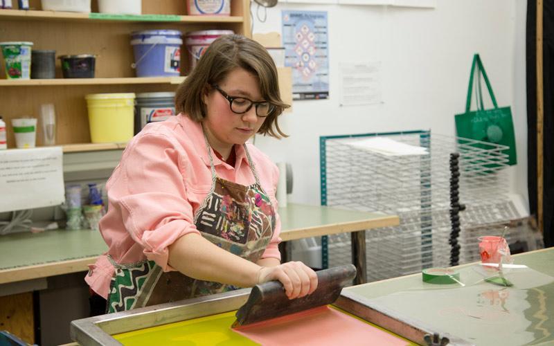Student using silkscreen press