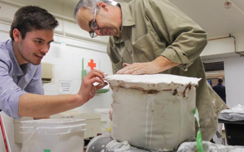 glen mackinnon and student working on sculpture