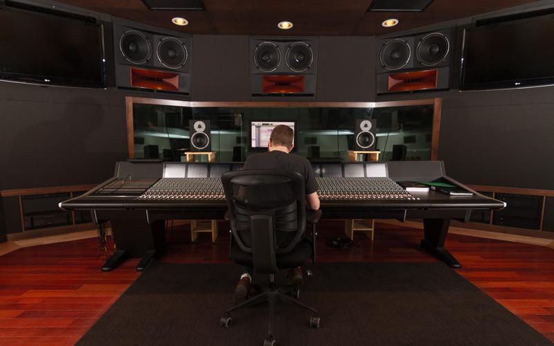 rear shot of student sitting at sound board