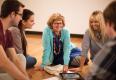 Leanne Elias (L) with a group, including graduate student Christine Clark (R).